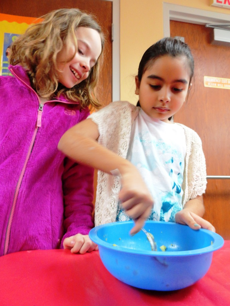 Sarah and Natalia make their own guacamole using avocado, garlic and just a dash of salt.