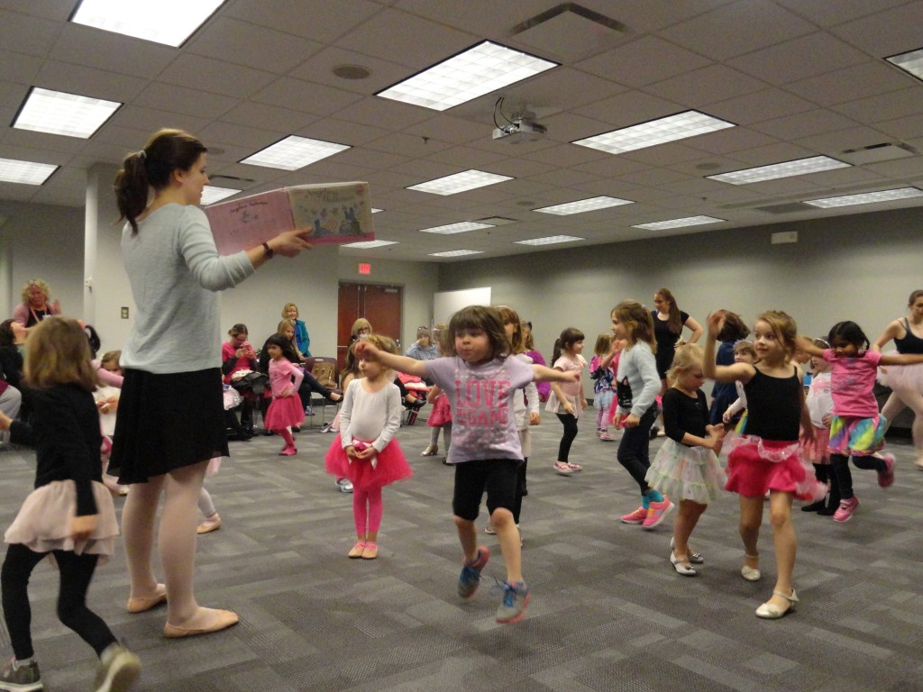 Jessica from The Fine Arts Association uses Angelina Ballerina to teach the girls basic ballet moves.