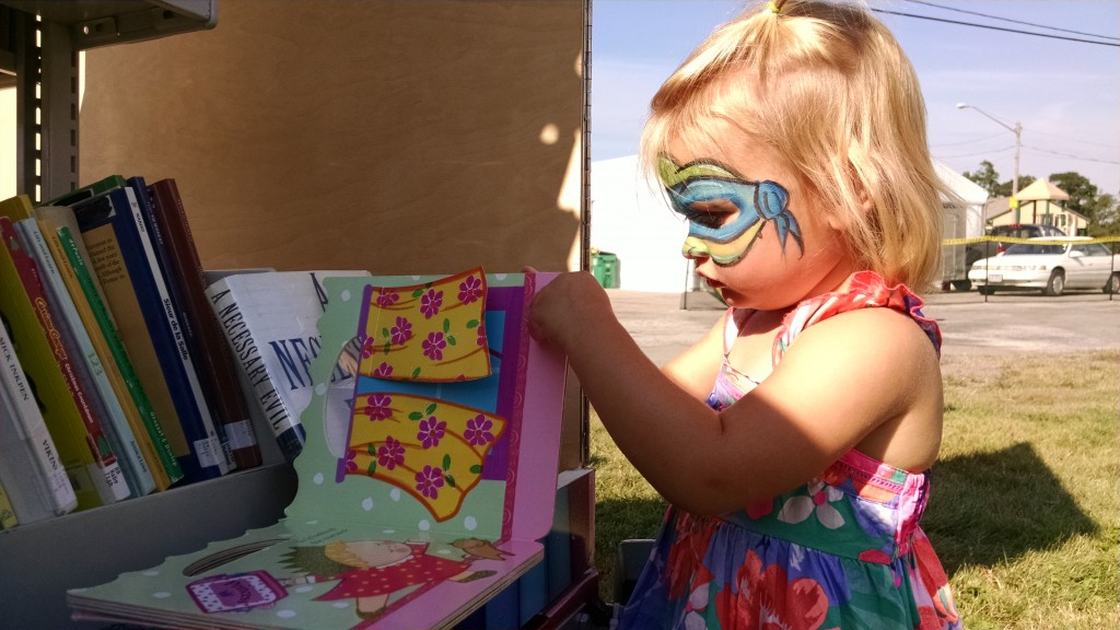 A girl picks through our Pop-Up Library during Concord Community Days. Where do you want our Pop-Up to appear next?