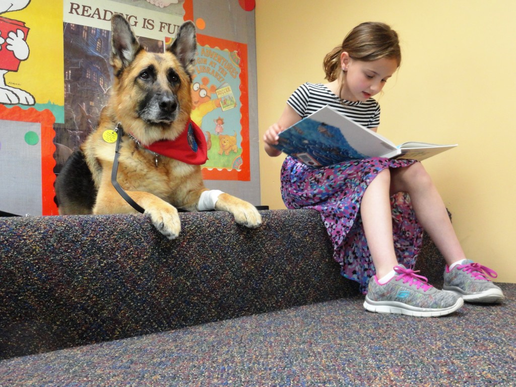 Caymen reads to Diva during Paws to Read at Mentor Public Library.