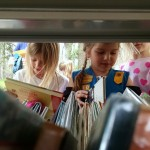 Children search the Pop-Up Library's shelves during an Earth Day program at Wildwood Cultural Center.
