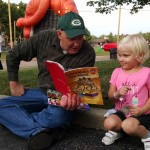 Paulina and her father break for story time during CityFest in Mentor.
