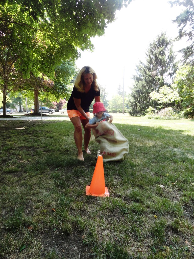 Zack gets a little help from his mother during the sack race.
