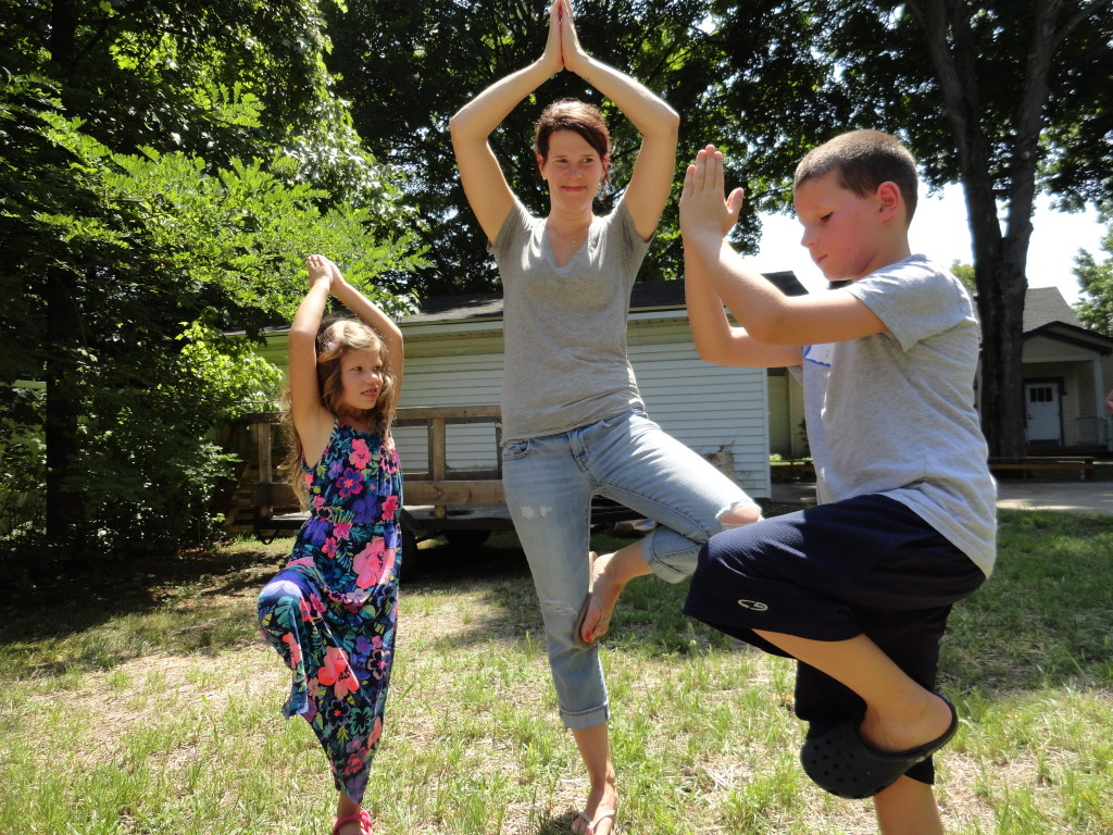 Adam, Emily, and even mom demonstrate their balance with a little tree pose.