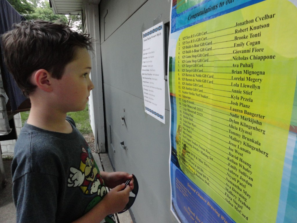 Jake scans to see if his name is on the list of Summer Reading prize winners. (Win or lose, we hope the kids also consider reading its own reward.)