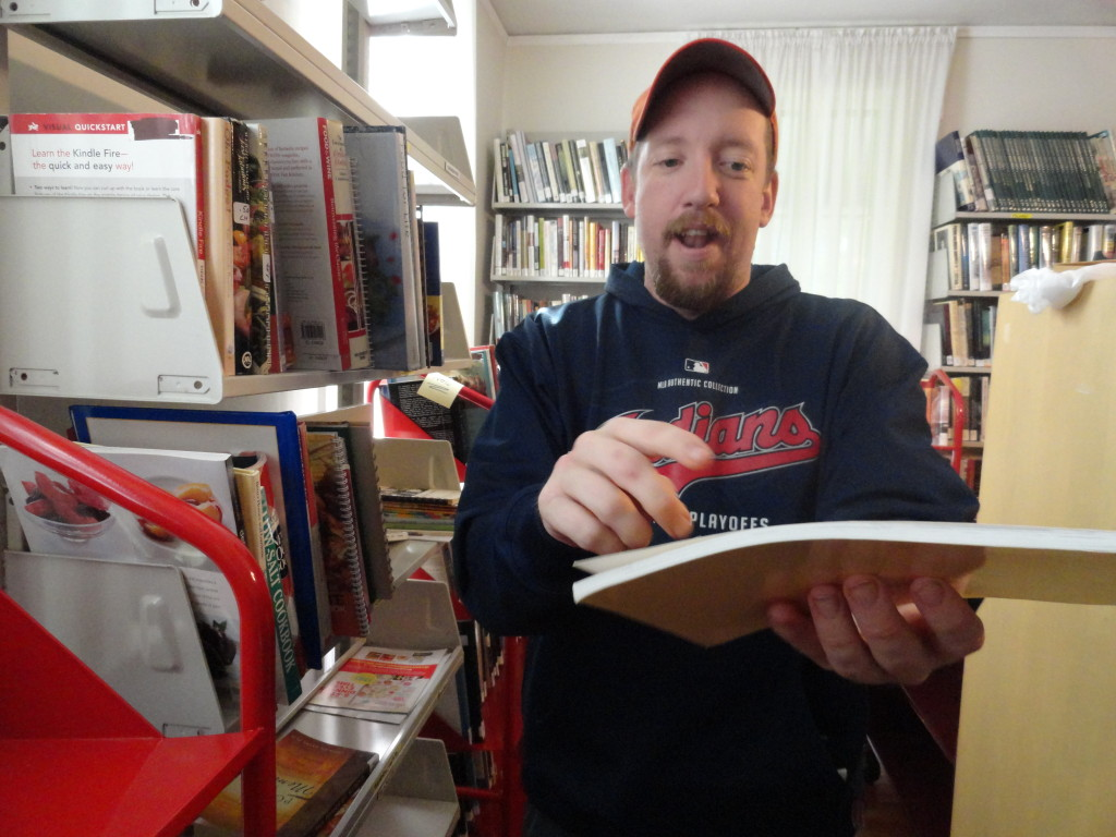 Martin Andersen likes one of the books he finds while volunteering in the Read House.