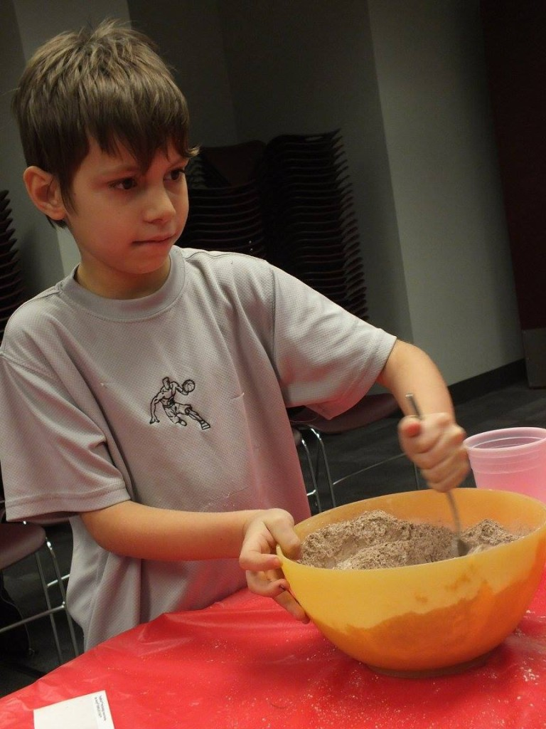 Avery stirs his hot cocoa during our Mix It Up program on Monday.
