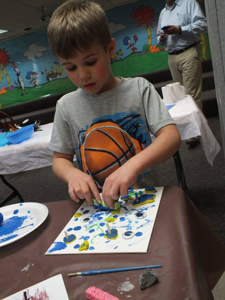 Justin adds a dash of eyeballs to his painting.