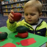 Kayden sees how many apples he can stack.
