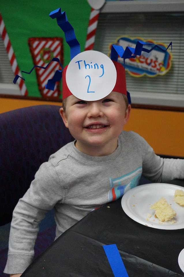 Patrick makes a Thing 2 hat to celebrate Dr. Seuss' birthday at Mentor Public Library.