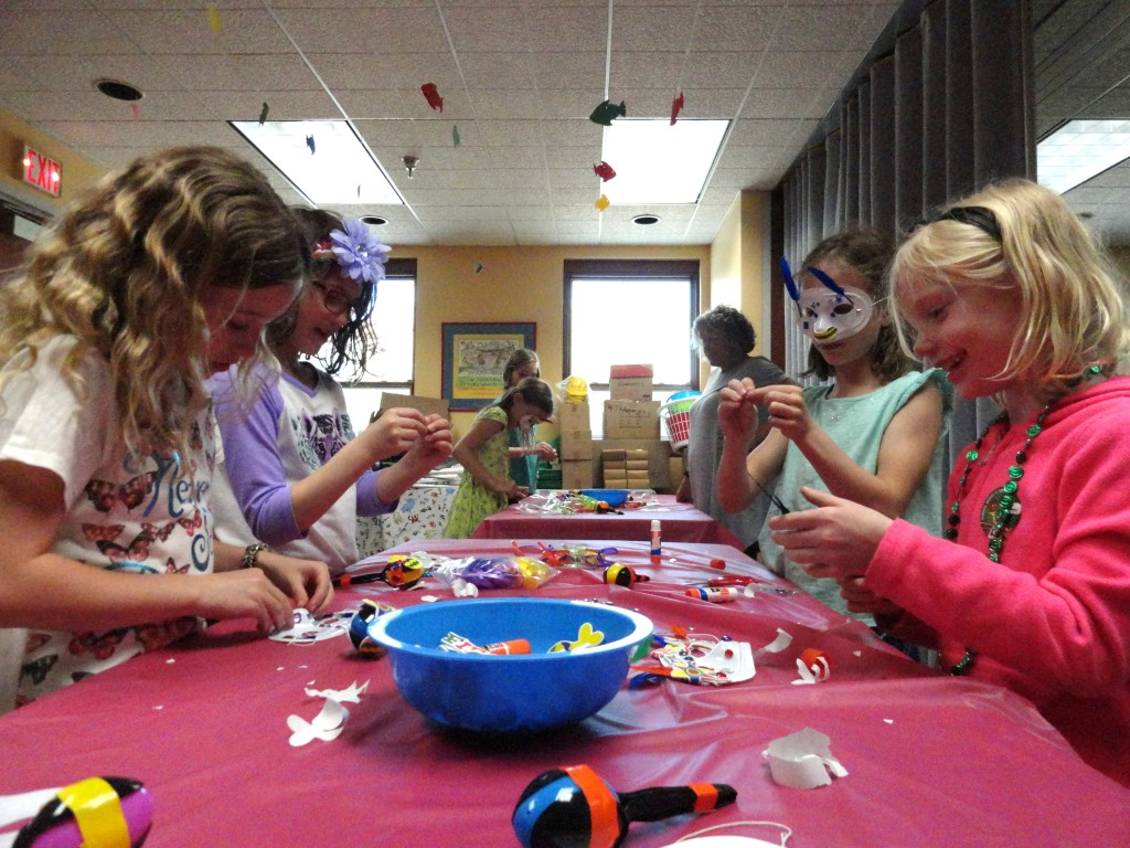 Our American Girl Book Club decorates their maracas.