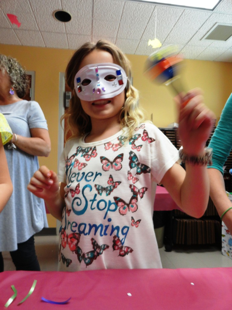 The girls prepared for Mardi Gras, making masks and maracas, during our American Girl Book Club meeting.