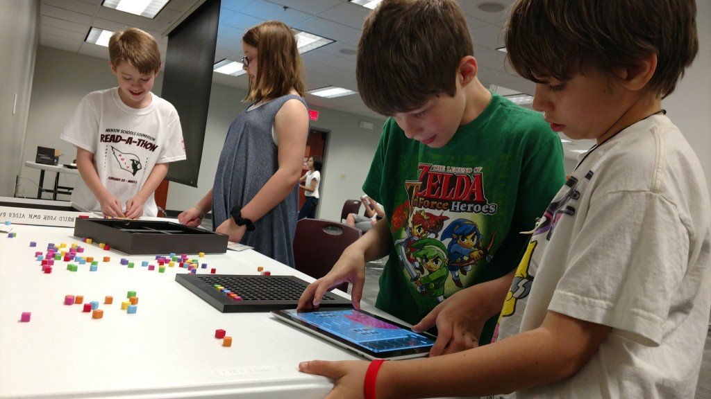 Our MPL Arcade kids built their own Mario Kart levels out of blocks.