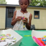 Aniyah decorates her maracas.