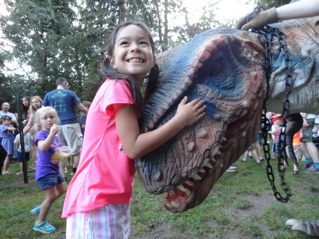 Roxie the Dinosaur gives one of our Super Readers a hug during our Summer Reading Finale Party.