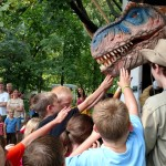 Children test Roxie the Dinosaur's reflexes during a quick game of Red Light Green Light.