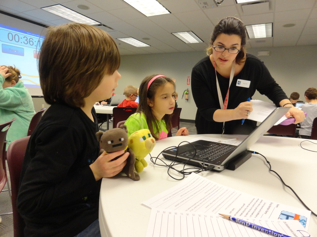 Ms. Amy helps kids with a digital scavenger hunt during a technology program at Mentor Public Library.