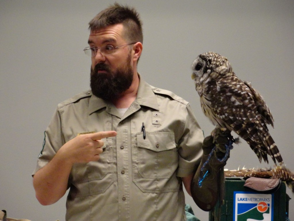 Tim Cunningham from Lake Metroparks introduces kids to Hemlock, a barred owl that lives in Penitentiary Glen.