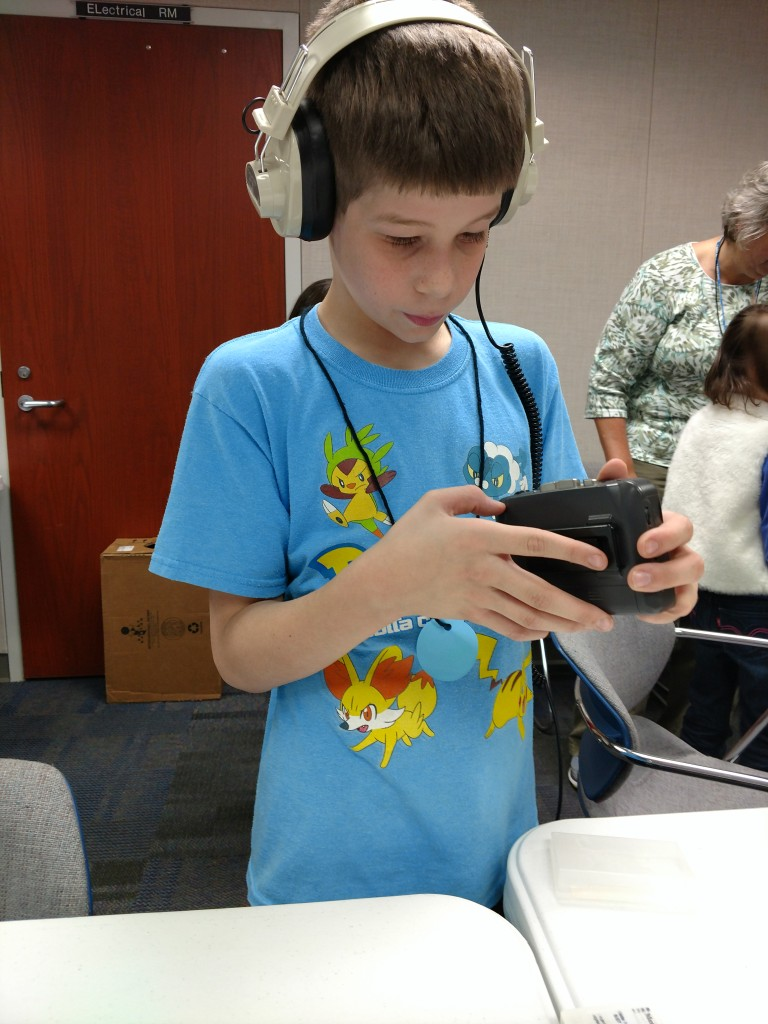 That Walkman is probably more than twice the age of the child.