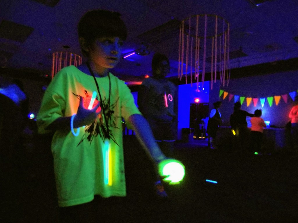 Eli plays a round of glow bowling.