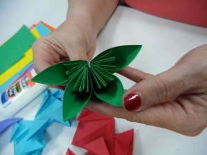 People celebrate summer by making paper flowers during our origami program.