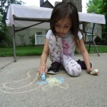 Delayna draws her own bumblebee dance in the backyard of our Read House.