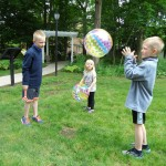 Kids practice animal sounds with a game that includes a nursery rhyme and beach ball.