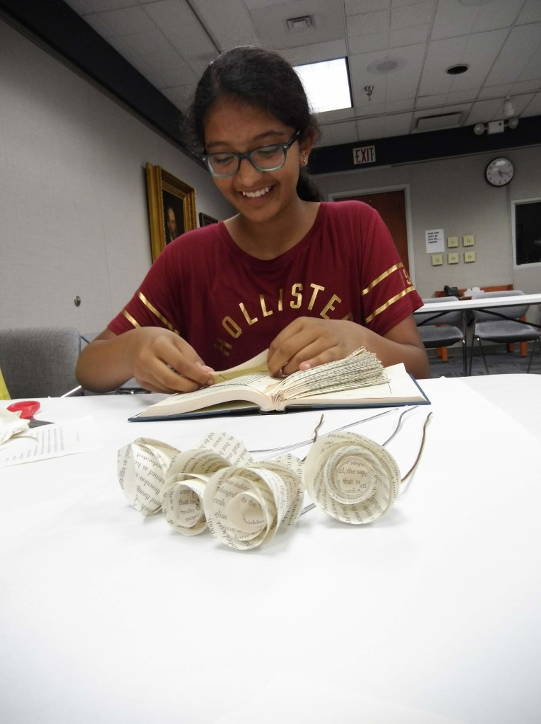 Rhea transforms a book into a sculpture with book folding.