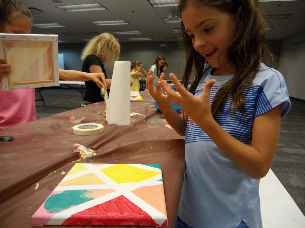 Kids made eye-catching wall art with paint and masking tape at Mentor Public Library.