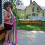 Aria tries out her colorful puili stick.