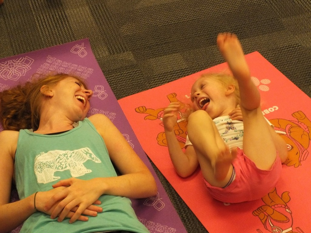 Sharing a laugh during Beach Blanket Yoga at Mentor Public Library