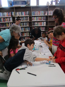 "Kids learn the basics of coding by ""training"" the library's Ozobots."