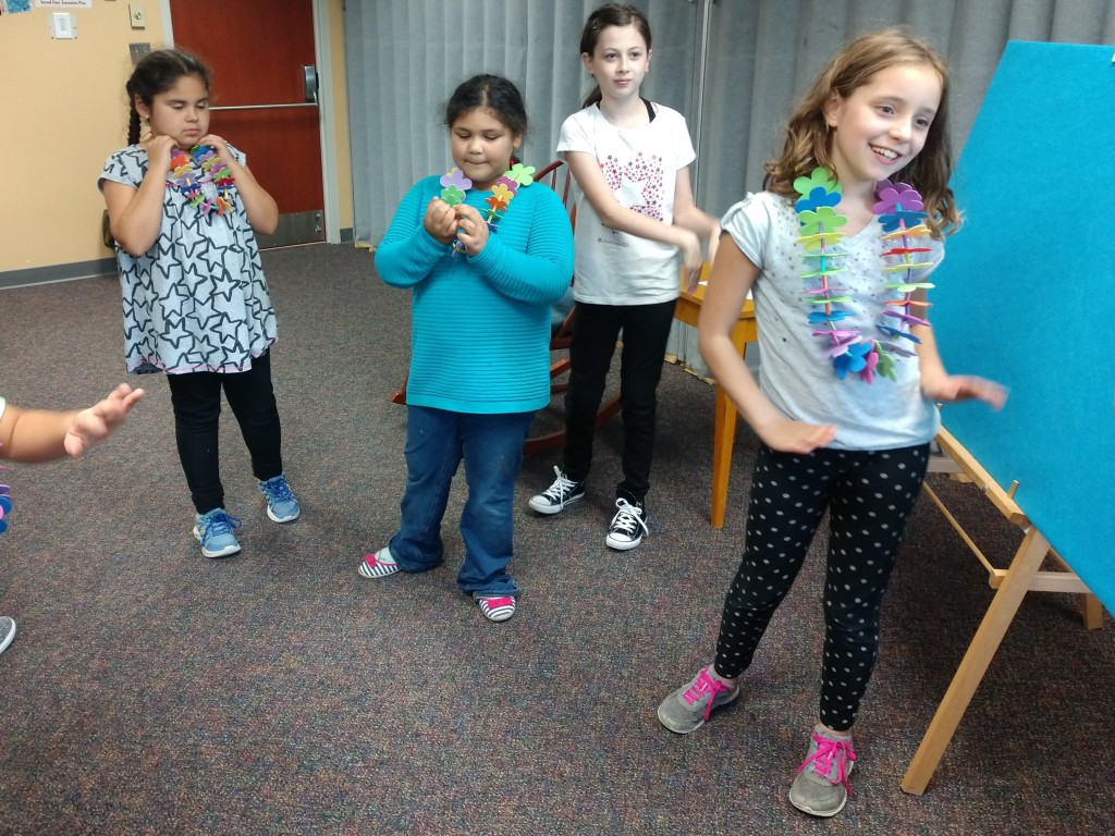 The girls in our American Girl Book Club practice the hula.
