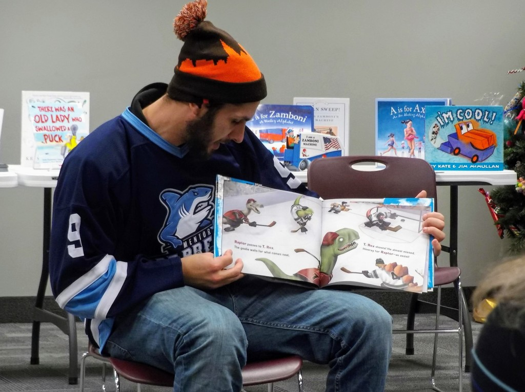 Nathan Farrington ofthe Mentor Ice Breakers introduces the kids to DINO-HOCKEY during story time at Mentor Public Library.