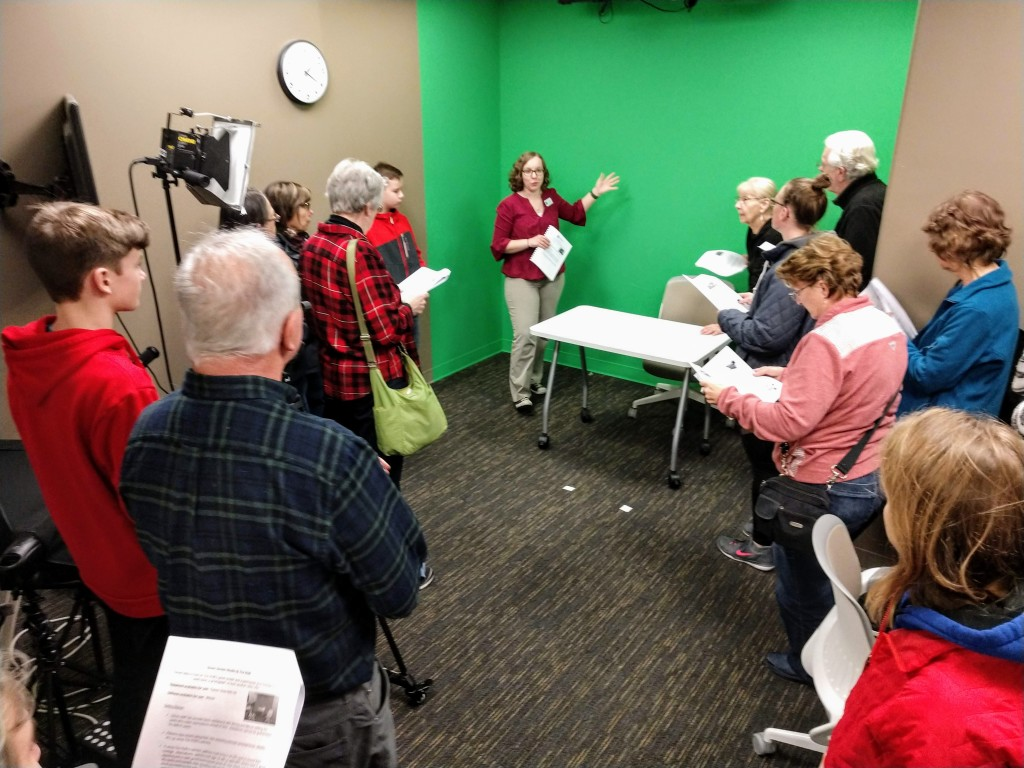 Ariel, our HUB manager, takes patrons on a tour of the green-screen studio at The HUB's makerspace.