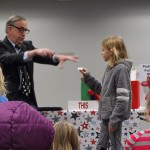 Mr. Zap waves his wand during the kickoff party for the Mentor Schools Foundation Read-a-Thon