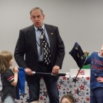 Mr. Zap borrows a little magic from the crowd during the Read-a-Thon kickoff party at the library.