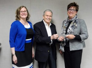 Mentor Public Library Executive Director Cheryl Kuonen (left) and Board of Trustees President Diane Wantz thank Charles N. Higgins Jr., the trustee of the
