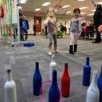 Ava and Juliana show off their aim in our ring toss game