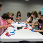Kids make 3D glasses at Mentor Public Library's Main Branch.