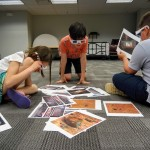 Young scientists look at 3D photos from NASA's Mars Rover.