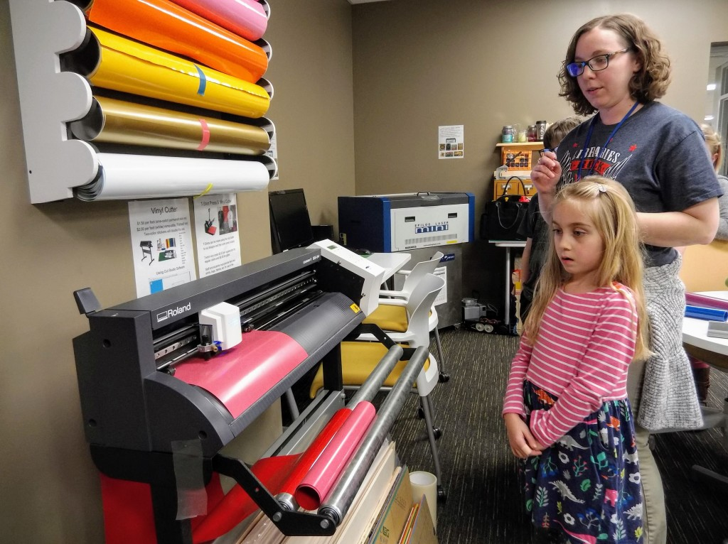 You can use the makerspace's vinyl cutter to make custom stickers, shirts and more.
