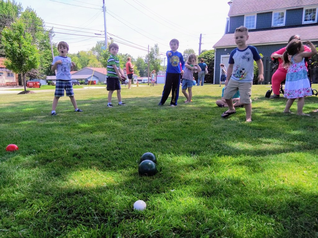 Kids play bocce on the Lake Branch's lawn.