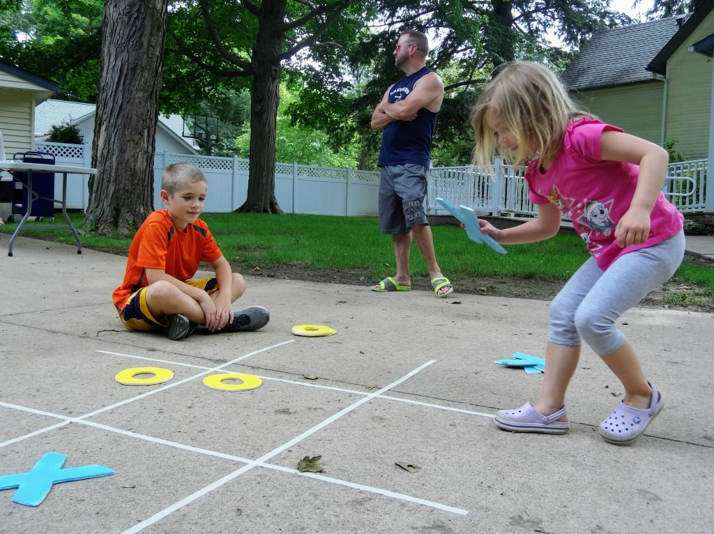 Kids play tic-tac-toe on the Main Branch lawn during another Marvelous Monday.
