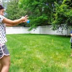 Playing water balloon toss