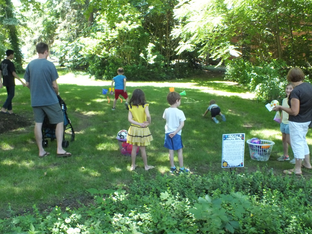 Kids compete in a planetary relay race outside of our Main Branch.