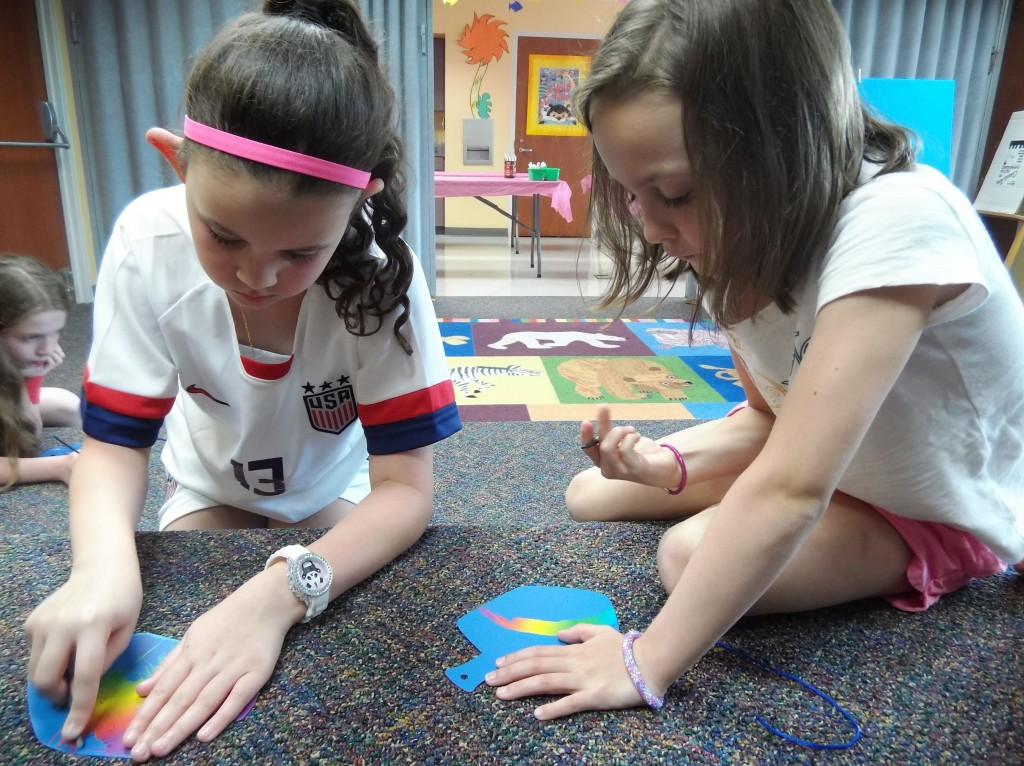 The girls from our American Girl Book Club made scratch art dreidels and menorahs during their July meeting.