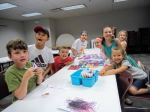 Our young artists show off their infinity puzzle.