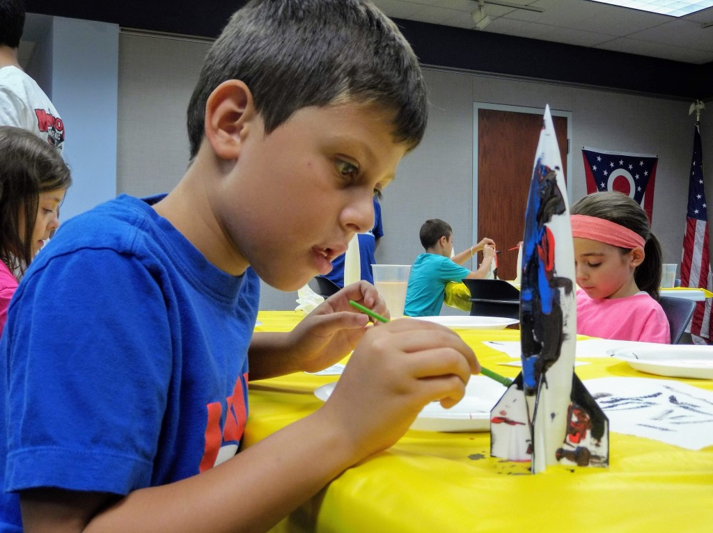 Kids paint rocket ships that were 3D printed at Mentor Public Library.