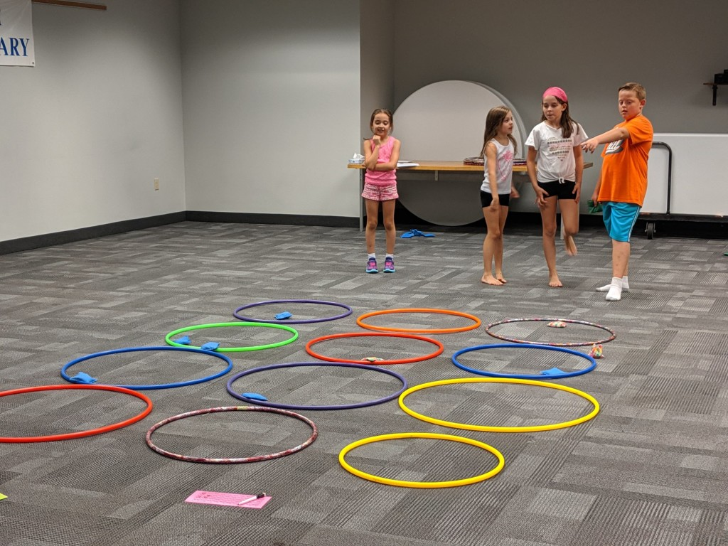 Kids test their math skills during relays at Mentor Public Library's Main Branch.